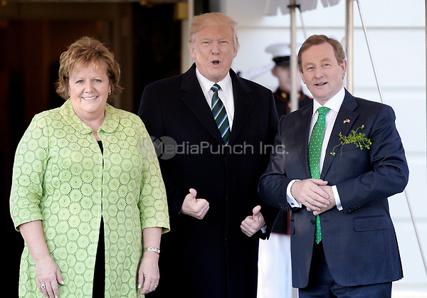 United States President Donald J. Trump  welcomes Prime Minister Enda Kenny of Ireland and his wife Fionnuala Kenny on the South Portico of the White House in Washington, DC on March 16, 2017 in Washington, DC. <br /> Credit: Olivier Douliery / Pool via CNP /MediaPunch