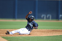 PEORIA - MARCH 5:  Chone Figgins of the Seattle Mariners slides into second base during a spring training game against the San Diego Padres on March 5, 2010 at the Peoria Sports Complex in Peoria, Arizona. (Photo by Brad Mangin)