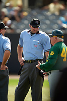 Umpire Travis Carlson talks with head coach Tony Rossi (40) during a UCF Knights game against the Siena Saints on February 21, 2016 at Jay Bergman Field in Orlando, Florida.  UCF defeated Siena 11-2.  (Mike Janes/Four Seam Images)