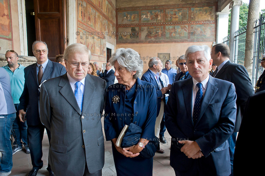 Roma 19 Agosto 2014.<br /> Commemorazione di Alcide De Gasperi a 60 anni dalla morte nella basilica di San Lorenzo fuori le mura dove si trova la tomba dello statista, nel portico della basilica. Pierluigi Castagnetti (L), Flavia Piccoli Nardelli (C), Ivano Strizzolo (R), in rappresentanza del Partito Democratico<br /> Rome, Italy. 19th August 2014 -- Commemoration of Alcide De Gasperi 60 years after his death in the Basilica of San Lorenzo outside the walls, where there is the tomb of the statesman, in the porch of the basilica. Pierluigi Castagnetti (L), Flavia Piccoli Nardelli (C), Ivano Strizzolo (R), representing the Democratic Party