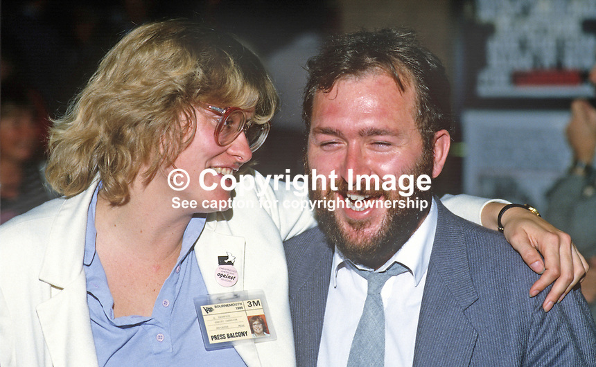 Marjorie Thompson, USA-born, CND, Campaign for Nuclear Disarmament, UK, enjoys a joke with Tim Williams, researcher for Dafydd Elis Thomas, MP, Plaid Cymru, at 1985 Labour Party Conference. 19851048MT.<br /> <br /> Copyright Image from Victor Patterson, 54 Dorchester Park, Belfast, UK, BT9 6RJ<br /> <br /> t: +44 28 90661296<br /> m: +44 7802 353836<br /> vm: +44 20 88167153<br /> e1: victorpatterson@me.com<br /> e2: victorpatterson@gmail.com<br /> <br /> For my Terms and Conditions of Use go to www.victorpatterson.com