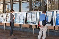 Passersby read the front pages of the day's newspapers in front of the Newseum museum of news in Washington, DC