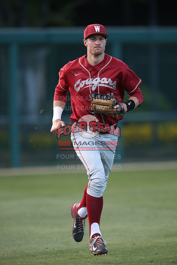 Ben Roberts (11) of the Washington State Cougars returns to the dugout between innings during a game against the Southern California Trojans at Dedeaux Field on March 13, 2015 in Los Angeles, California. Southern California defeated Washington State, 10-3. (Larry Goren/Four Seam Images)