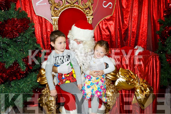 Santa Arriving On Saturday At Manor West Retail Centre. Pictured Matthew O'Sullivan and Kayley O'sullivan with Santa