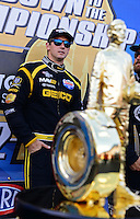 Sept. 14, 2012; Concord, NC, USA: NHRA top fuel dragster driver Morgan Lucas near the championship trophy during qualifying for the O'Reilly Auto Parts Nationals at zMax Dragway. Mandatory Credit: Mark J. Rebilas-