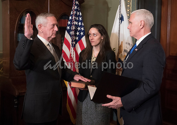 Marine Corps General James Mattis is sworn-in as Defense Secretary by Vice President Mike Pence, in the Vice Presidential ceremonial office in the Executive Office Building in Washington, D.C. on January 20, 2017. Photo Credit: Kevin Dietsch/CNP/AdMedia