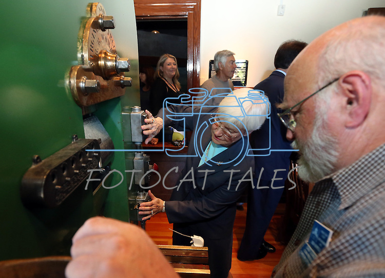 Coiner Ken Hopple watches Patty Cafferata mint a medallion of the fourth and final in a commemorative Sesquicentennial series at the Nevada State Museum, in Carson City, Nev., on Wednesday, Sept. 3, 2014. <br /> Photo by Cathleen Allison