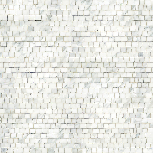 Staggered 2 cm, a hand-chopped stone mosaic, shown in honed Calacatta.