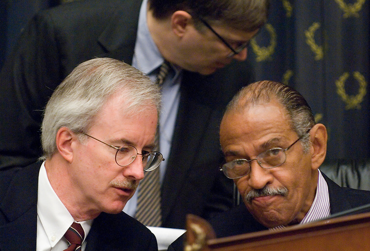 George Slover, left, counsel to the committee, speaks with chairman John Conyers, D-Mich., as the House Judiciary Committee considers issuing ?contempt of Congress Citations to former White House Counsel Harriet Miers and White House Chief of Staff Joshua Bolton, on Wednesday, July 25, 2007, following their refusal to comply with subpoenas issued in the U.S. Attorney investigation.