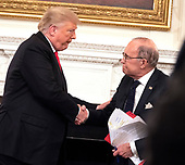 """United States President Donald J. Trump shakes the hand of Director of the National Economic Council Larry Kudlow  at the conclusion of """"Our Pledge to America's Workers"""" event at The White House in Washington, DC, October 31, 2018. Credit: Chris Kleponis / Pool via CNP"""