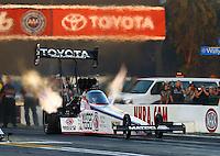 Feb 6, 2015; Pomona, CA, USA; NHRA top fuel driver Antron Brown during qualifying for the Winternationals at Auto Club Raceway at Pomona. Mandatory Credit: Mark J. Rebilas-