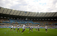 The Germany starting eleven go through their warm up inside the Estadio Mineirao de Belo Horizonte before kick off