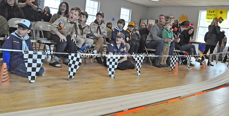 KENT, CT – 22 March 2014 - 032214LMW04 – Kent Cub Scouts react to a particularly close finish during one of the heats at the Kent Pinewood Derby held Saturday by Pack 11. Lynn Mellis Worthington Republican-American