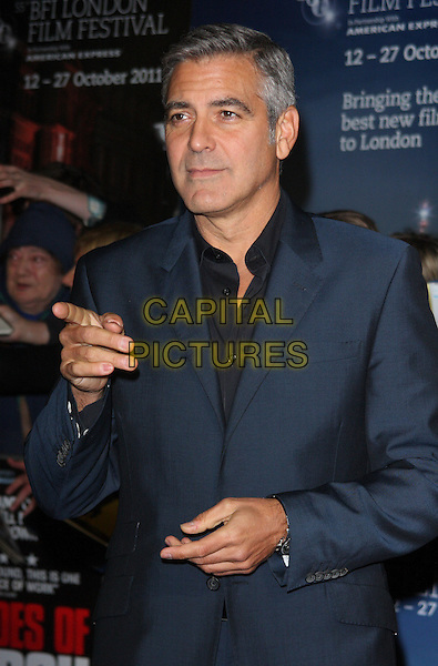 George Clooney.'The Ides Of March' UK premiere, London Film Festival, Odeon Leicester Square cinema,  Leicester Square, London, England..19th October 2011.LFF half length blue suit jacket black shirt hands finger pointing  .CAP/ROS.©Steve Ross/Capital Pictures.