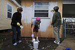 "(L-r) Laurie Levin, 61, Patti Vile, 65, and Mildred Shepherd, 68, ""voluntourists"" from Glencoe, Illinois, prime a shed beside the new home for Aniece Gibbs, 89, in the Hollygrove section of New Orleans, Louisiana on March 11, 2008.  The group of ""voluntourists"" from Glencoe, Illinois is traveling to New Orleans to combine traditional tourism with volunteer work in the aftermath of the devastation wrought by Hurrica Katrina in 2005."