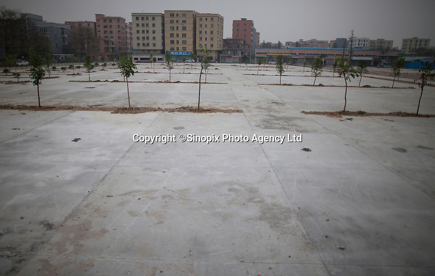 A demolished factory site is seen opposite the Yue Yuen Industrial Holdings Limited factory in Dongguan, Guangdong Province, China, 03 March 2015.