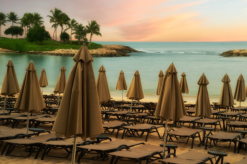 Beach chairs and umbrellas not opened before the day begins. Ko Olina, Oahu, Hawaii