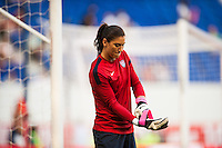 United States (USA) goalkeeper Hope Solo (1) puts on her gloves during warmups prior to playing the Korea Republic (KOR). The women's national team of the United States defeated the Korea Republic 5-0 during an international friendly at Red Bull Arena in Harrison, NJ, on June 20, 2013.