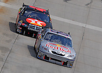 Jun 1, 2008; Dover, DE, USA; NASCAR Sprint Cup Series driver A.J. Allmendinger (84) leads Juan Pablo Montoya (42) during the Best Buy 400 at the Dover International Speedway. Mandatory Credit: Mark J. Rebilas-US PRESSWIRE
