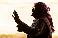 A Bedouin man gestures while having a conversation. Near Mitzpe Ramon, in the Negev Desert, Israel