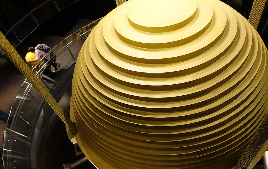 A gigantic suspended tuned mass damper, or hanging ball, takes up four stories inside Taipei 101 (the world's third tallest building) and works to prevent the building from swaying and/or falling over. The 730-ton sphere is visible from the observation deck level of the tower, formerly the world's tallest building.