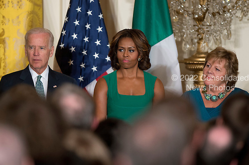 United States President Barack Obama hosts a St. Patrick's Day reception attended by Prime Minister Enda Kenny of Ireland in the East Room of the White House in Washington, D.C. on Friday, March 14, 2014.  From left to right: U.S. Vice President Joe Biden, first lady Michelle Obama, and Fionnuala O'Kelly, wife of Prime Minister Kenny.<br /> Credit: Ron Sachs / Pool via CNP