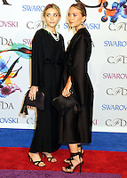 NEW YORK CITY, NY, USA - JUNE 02: Ashley Olsen and Mary-Kate Olsen arrive at the 2014 CFDA Fashion Awards held at Alice Tully Hall, Lincoln Center on June 2, 2014 in New York City, New York, United States. (Photo by Celebrity Monitor)