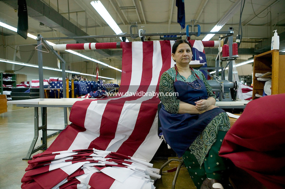 21 June 2005 - Oaks, PA - Naila Qasim Hashmi rests during her lunch break at the Annin & Co. American flag manufacturing plant in Oaks, PA. Photo Credit: David Brabyn.