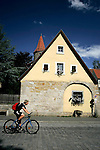 A cyclist rides in Rothenburg ob der tauber, Germany, August 02, 2008. (ALTERPHOTOS/Alvaro Hernandez)