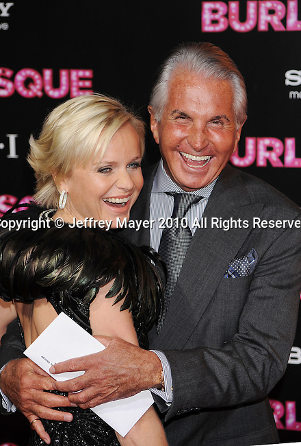 "HOLLYWOOD, CA. - November 15: Barbara Sturm and George Hamilton. arrive at the Los Angeles ""Burlesque"" Premiere at Grauman's Chinese Theatre on November 15, 2010 in Hollywood, California."