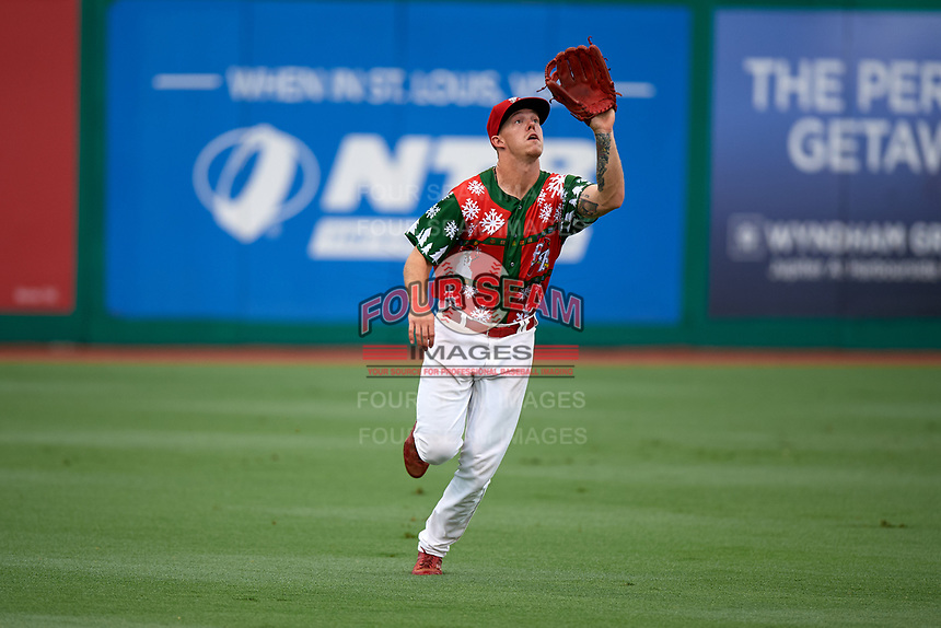 """Palm Beach Cardinals left fielder Shane Billings (22) settles under a fly ball during a game against the Charlotte Stone Crabs on July 22, 2017 at Roger Dean Stadium in Palm Beach, Florida.  The Cardinals wore special """"Ugly Sweater"""" jerseys for Christmas in July.  Charlotte defeated Palm Beach 5-2.  (Mike Janes/Four Seam Images)"""