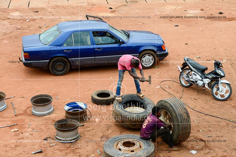 BURKINA FASO, Bobo Dioulasso, roadside car workshop, tyre repairing