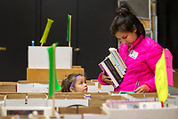 NWA Democrat-Gazette/JASON IVESTER<br /> Shannon Matlock and her daughter Lucy Matlock, 5, look over books Thursday, May 4, 2017, at Vandergriff Elementary School in Fayetteville where Shannon's other daughter, Jillian Matlock, is a first-grader. The book sale continues today (FRIDAY) with proceeds going to benefit the Fayetteville Animal Services.