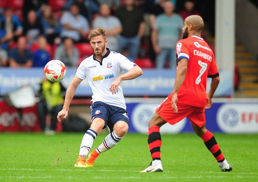Bolton Wanderers' James Henry under pressure from Walsall's Adam Chambers<br /> <br /> Photographer Kevin Barnes/CameraSport<br /> <br /> The EFL Sky Bet League One - Walsall v Bolton Wanderers - Saturday 17th September 2016 - Banks's Stadium - Walsall<br /> <br /> World Copyright &copy; 2016 CameraSport. All rights reserved. 43 Linden Ave. Countesthorpe. Leicester. England. LE8 5PG - Tel: +44 (0) 116 277 4147 - admin@camerasport.com - www.camerasport.com