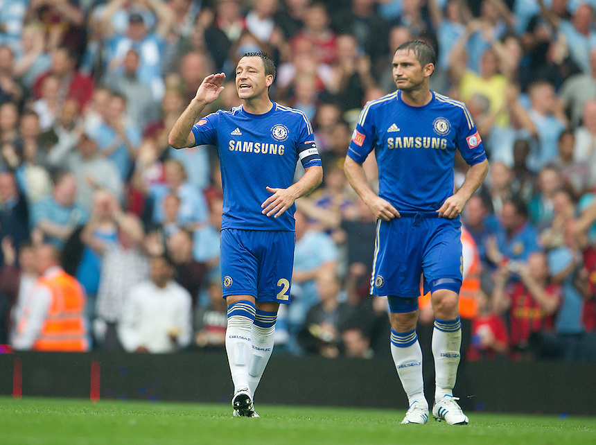 Chelsea's John Terry (L) and Frank Lampard show frustration as Manchester City celebrate their third goal..Football Friendly - FA Community Shield - Chelsea v Manchester City - Sunday 12th August 2012 - Villa Park - Birmingham..