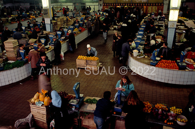 """Moscow, Russia<br /> Soviet Union<br /> December 16, 1991<br /> <br /> The Leningradski Market seen full of food, yet there were few buyers do to the high prices. <br /> <br /> In December 1991, food shortages in central Russia had prompted food rationing in the Moscow area for the first time since World War II. Amid steady collapse, Soviet President Gorbachev and his government continued to oppose rapid market reforms like Yavlinsky's """"500 Days"""" program. To break Gorbachev's opposition, Yeltsin decided to disband the USSR in accordance with the Treaty of the Union of 1922 and thereby remove Gorbachev and the Soviet government from power. The step was also enthusiastically supported by the governments of Ukraine and Belarus, which were parties of the Treaty of 1922 along with Russia.<br /> <br /> On December 21, 1991, representatives of all member republics except Georgia signed the Alma-Ata Protocol, in which they confirmed the dissolution of the Union. That same day, all former-Soviet republics agreed to join the CIS, with the exception of the three Baltic States."""