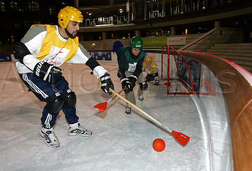 26 January 2005: Two Players challenge for the ball during a Men's Broomball League match played at the Broadgate Ice Rink, Broadgate, London. Photo: Neil Tingle/Action Plus..050126 winter sport sports wintersport wintersports male men broom ball