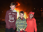 David Cebels, Sean Whelan and Shannon Cooney at the bonfire in Yellowbatter. Photo:Colin Bell/pressphotos.ie