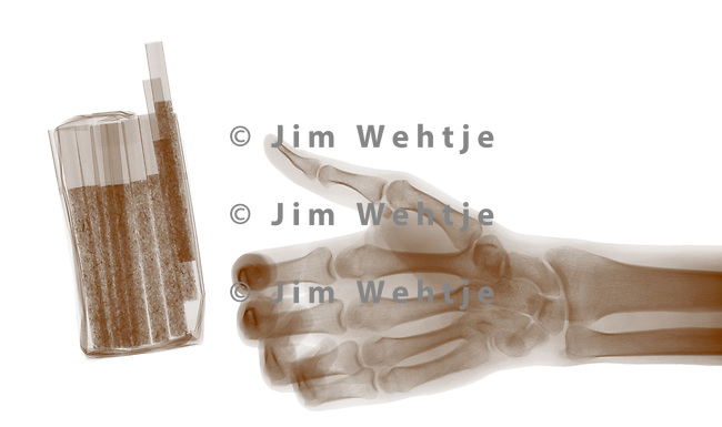 X-ray image of cigarettes and hand (brown on white) by Jim Wehtje, specialist in x-ray art and design images.
