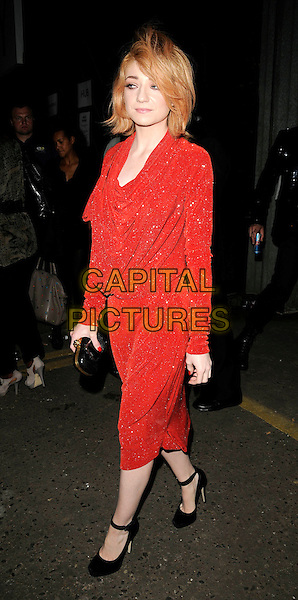 NICOLA ROBERTS (Girls Aloud).At the Vivienne Westwood Show, London Fashion Week Day 3, The Old Sorting Office, London, England, UK,.September 20th 2009..full length red dress long sleeved cowel neck black shoes ankle strap mary janes clutch bag draped sparkly sleeves.CAP/CAN.©Can Nguyen/Capital Pictures.