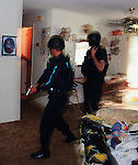 Members of the South Daytona Police Department tactical response team clear a home of any potential threat during a drug raid.(Brian Myrick)