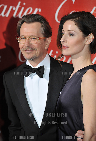 Gary Oldman & Alexandra Edenborough at the 2012 Palm Springs Film Festival Awards Gala at the Palm Springs Convention Centre..January 7, 2012  Palm Springs, CA.Picture: Paul Smith / Featureflash