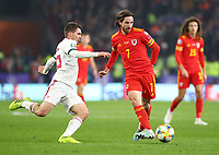 19th November 2019; Cardiff City Stadium, Cardiff, Glamorgan, Wales; European Championships 2020 Qualifiers, Wales versus Hungary; Joe Allen of Wales makes a pass as he is pressured by Mate Patkai of Hungary - Editorial Use