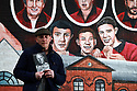 TO GO WITH SPORTS STORY BY Don McRae. Belfast Boxer Eamonn Magee stands near a mural showing him and his two brothers in the Ardoyne area of north Belfast. 01/05/2018 Photo/Paul McErlane
