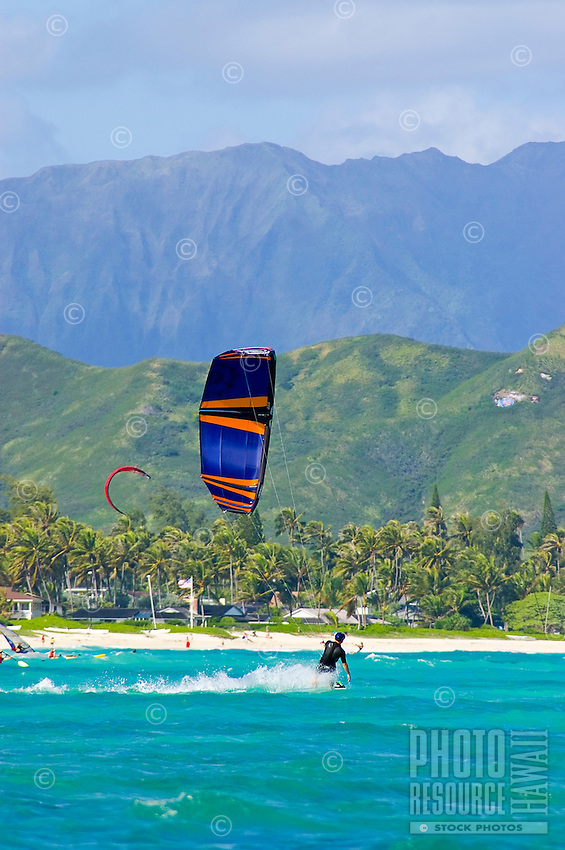 Kite surfer skims the waters of Kailua Bay.