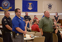 NWA Democrat-Gazette/BEN GOFF @NWABENGOFF<br /> Bella Vista Police officers stand to be recognized Friday, May 19, 2017, during a retirement ceremony and reception for Bella Vista Police Chief Ken Farmer at American Legion Post  341 in Bella Vista. Farmer began his law enforcement career in 1978 with the Benton County Sheriff's Office, working in the sheriff's office Bella Vista Division. Farmer started as a captain with the Bella Vista Police Department after the city incorporated in 2007, and became the department's chief in October 2009. James Graves has been hired as incoming chief, and will take over full responsibility as chief on June 1.