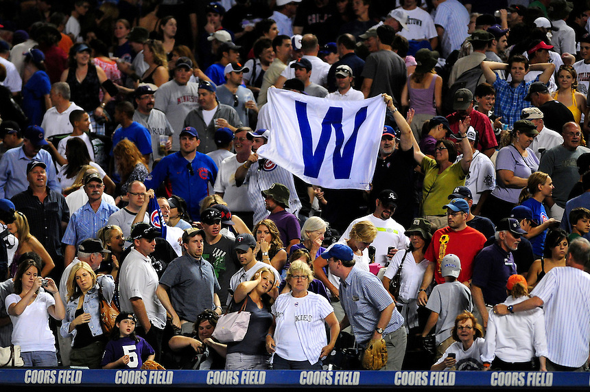"August 8, 2009: Chicago Cubs fans, which may have outnumbered Rockies fans at Coors Field, flash the ""W"" banner for a win during a regular season game between the Chicago Cubs and the Colorado Rockies at Coors Field in Denver, Colorado. The Cubs beat the Rockies 6-5. *****For editorial use only*****"