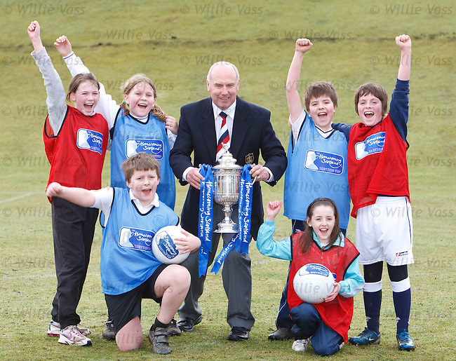 Falkirk hero Alex Totten with the Homecoming Scottish Cup at St Margaret's Primary School in Polmont