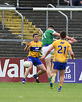 Josh Ryan of Limerick scores a goal despite Gordon Kelly of Clare during their Munster championship quarter-final game in Cusack park. Photograph by John Kelly.
