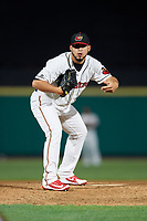 Rochester Red Wings relief pitcher Gabriel Moya (19) looks in for the sign during a game against the Pawtucket Red Sox on May 19, 2018 at Frontier Field in Rochester, New York.  Rochester defeated Pawtucket 2-1.  (Mike Janes/Four Seam Images)